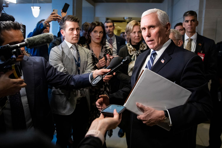 Vice President Mike Pence stops to talk to reporters briefly as he leaves the US Capitol after meeting with Congressional Democrats and Republicans on recent developments with the novel coronavirus March 4 in Washington, DC.