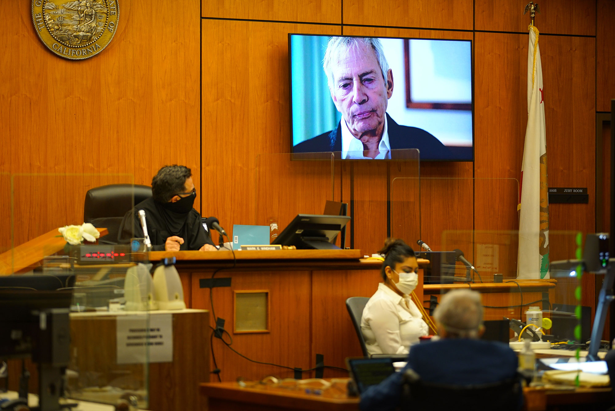 A TV still frame of Robert Durst appears on a screen as Deputy District Attorney John Lewin begins opening statements during court proceedings in his murder trial at Inglewood Courthouse on May 18, in California.