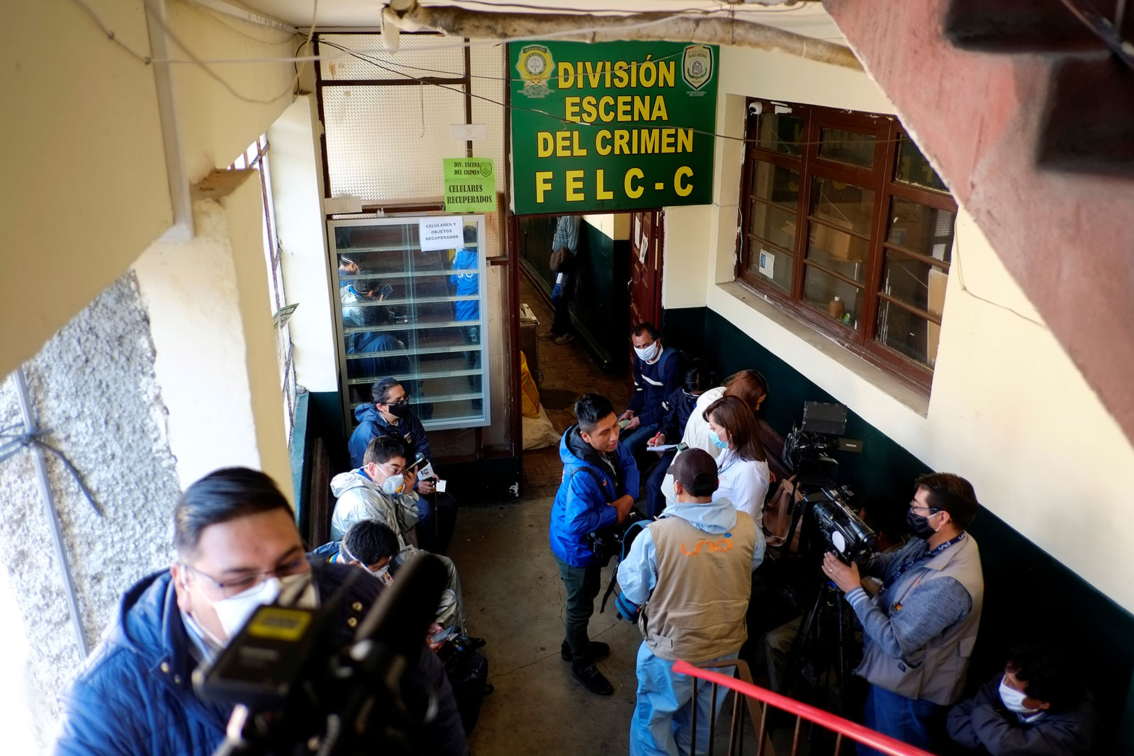 Journalists wait at a police station as Bolivian prosecutors launched a probe into potential corruption regarding overpriced purchases of ventilators, in La Paz, Bolivia on Wednesday.