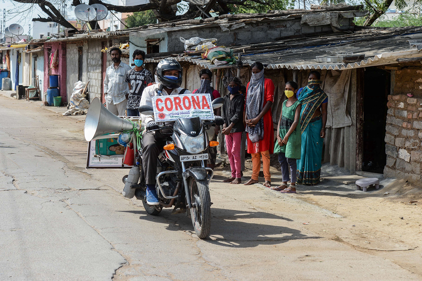 A man tours on his bike in the villages of Telangana state to spread awareness about Covid-19 in Hyderabad on May 21.