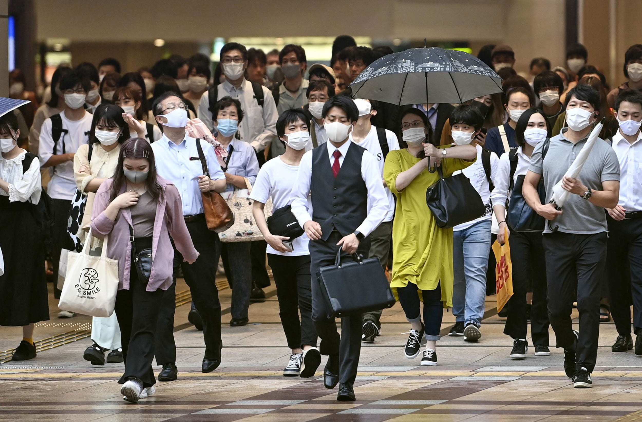 People walk in front of the JR Osaka Station in Japan on July 17. Osaka Prefecture reported 53 new cases of the novel coronavirus the same day.