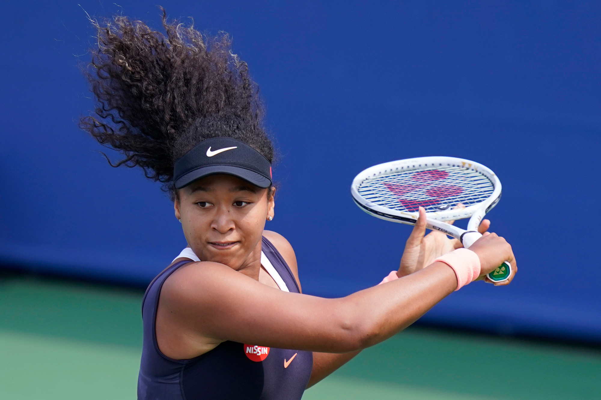 Naomi Osaka looks to return a shot during the quarterfinals at the Western & Southern Open tennis tournament on August 26 in New York.