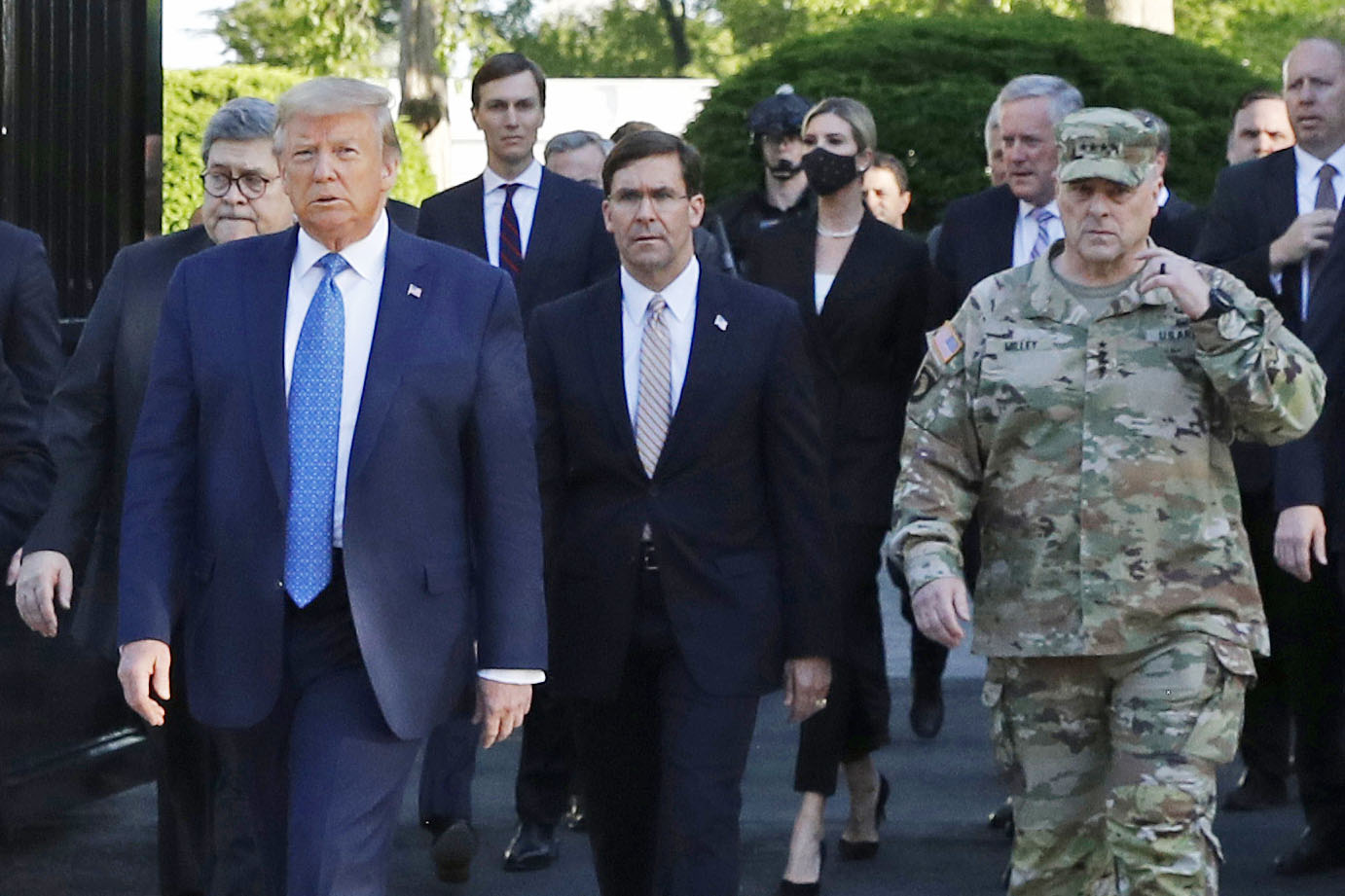 Gen. Mark Milley, right, walks with President Donald Trump, left, as Trump departs the White House to take a photo outside St. John's Church in Washington on June 1.