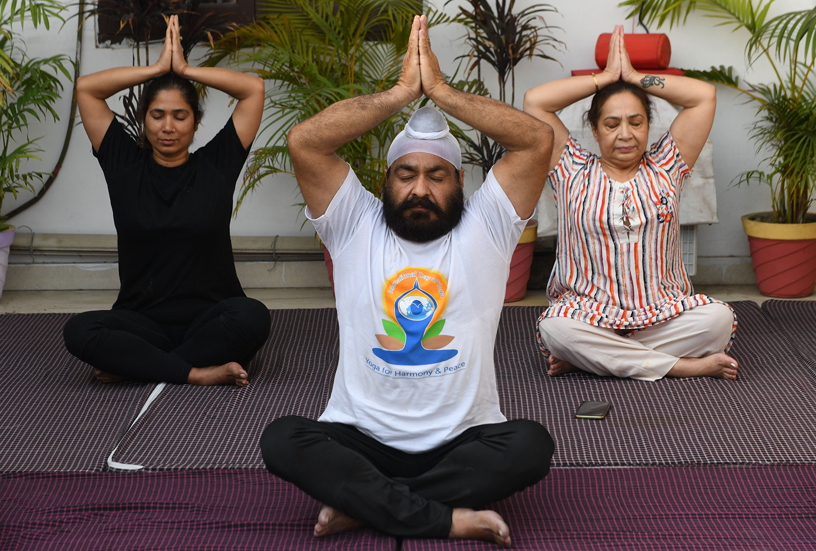 People perform yoga on the eve of the International Yoga Day, in Amritsar, India on June 20.