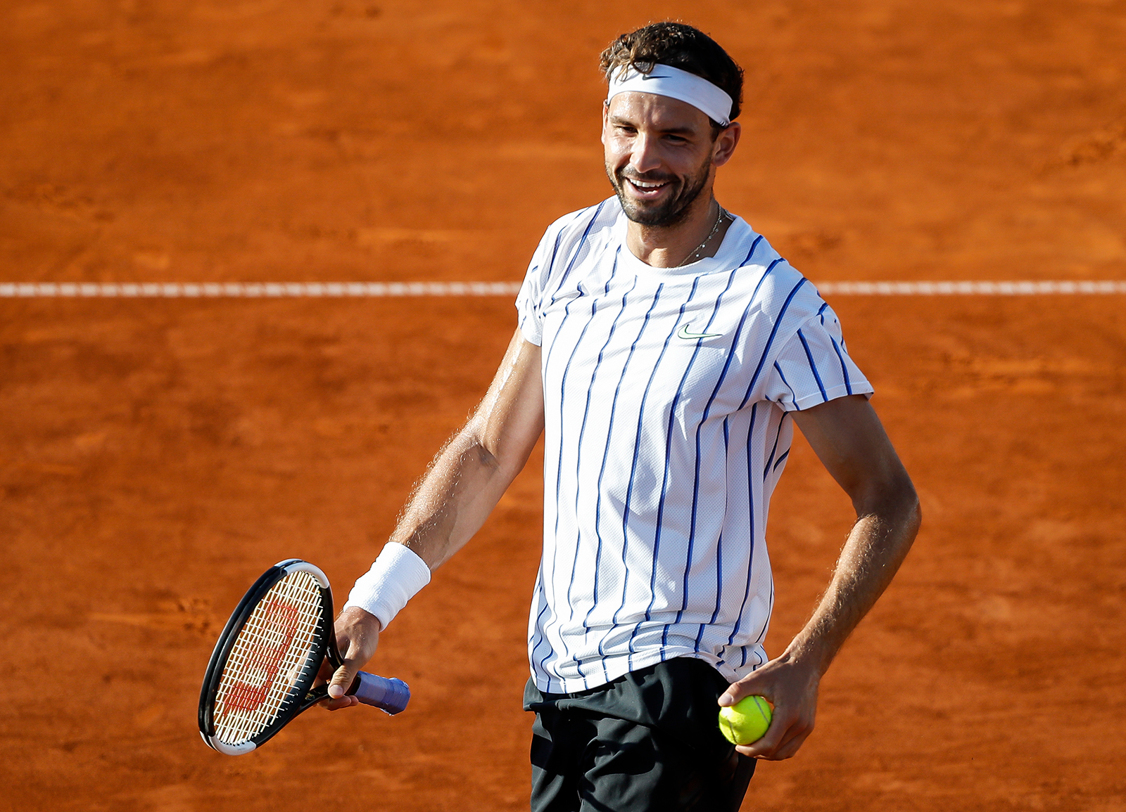 Grigor Dimitrov of Bulgaria reacts during his match at the Adria Tour charity exhibition hosted by Novak Djokovic on June 14, in Belgrade, Serbia.