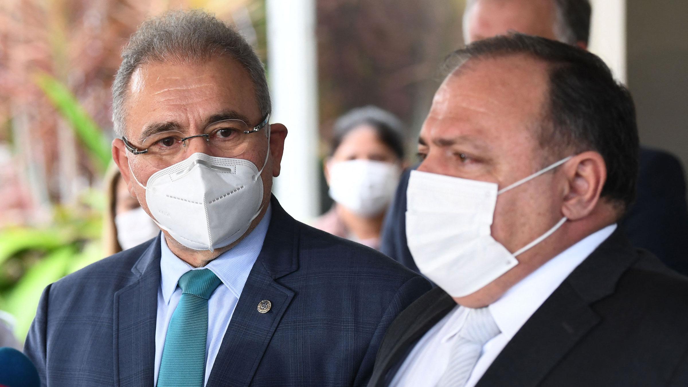 Dr. Marcelo Queiroga, left, succeeded Eduardo Pazuello, right, as Brazil's minister of health on Tuesday.