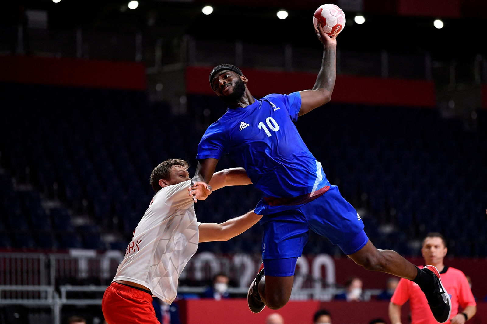 France's right back Dika Mem prepares to shoot during the men's final handball match between France and Denmark at the Tokyo 2020 Olympic Games at the Yoyogi National Stadium in Tokyo on August 7.