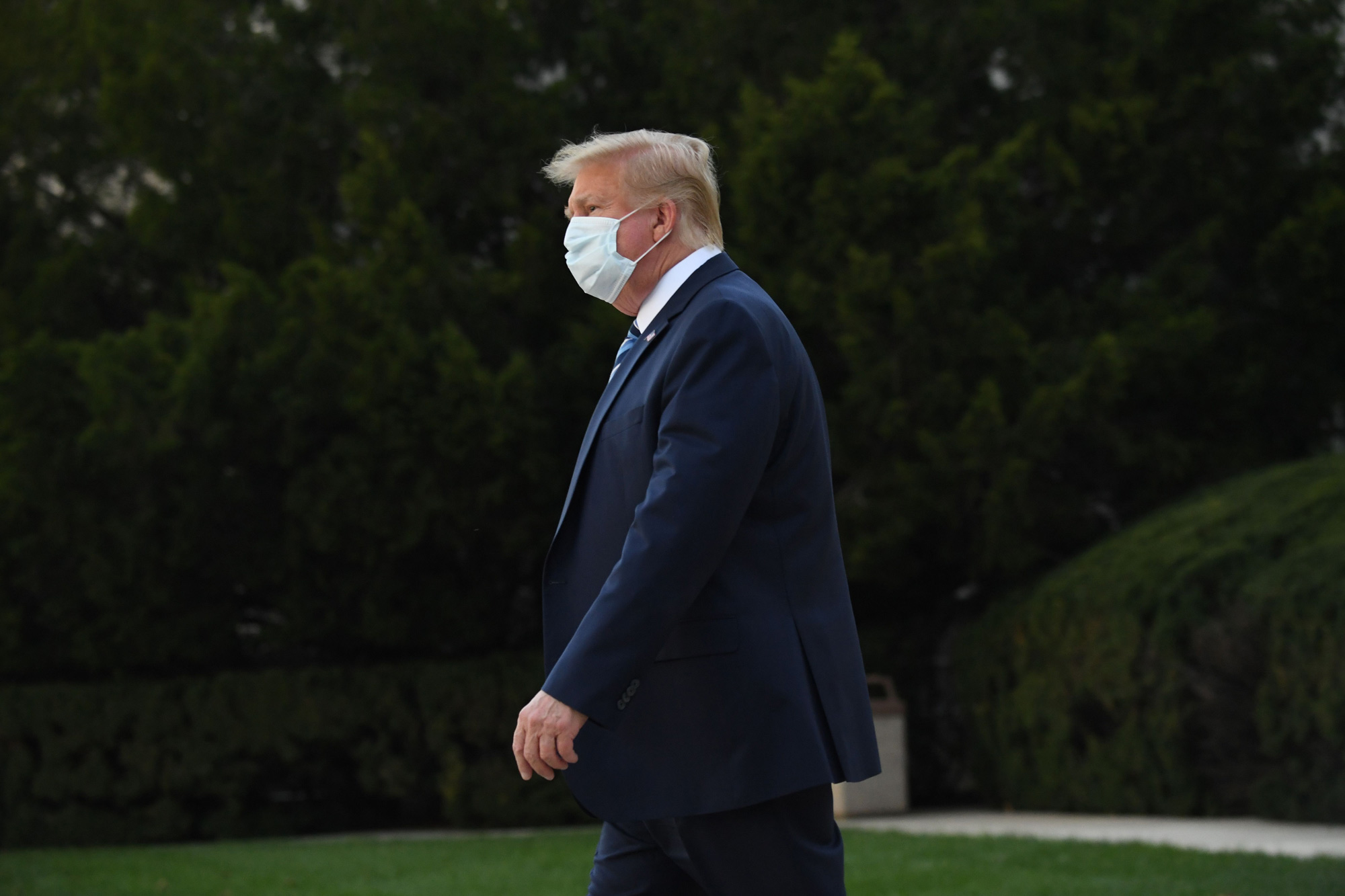 President Donald Trump leaves Walter Reed Medical Center in Bethesda, Maryland, heading towards Marine One on October 5.