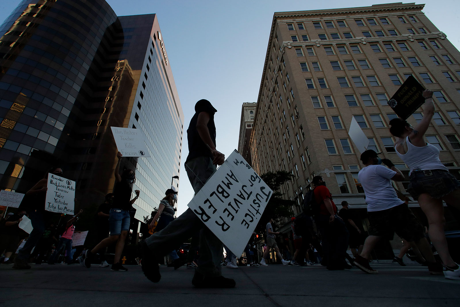 Demonstrators march in downtown Tulsa on Saturday evening.