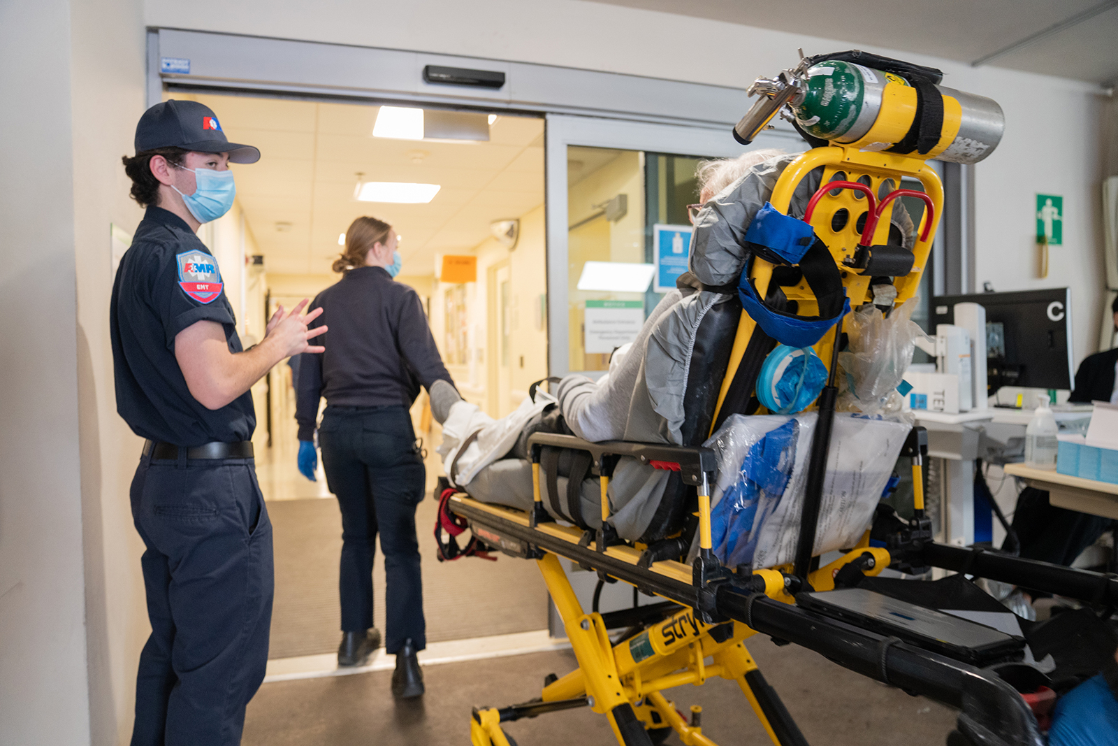 Paramedics arrive with a Covid-19 patient at the emergency department of Sharp Memorial Hospital in San Diego, California, on January 28.