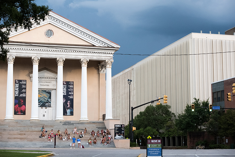 College students eat dinner at the Longstreet Theatre at the University of South Carolina on August 10, in Columbia, South Carolina. Students began moving back to campus housing August 9.