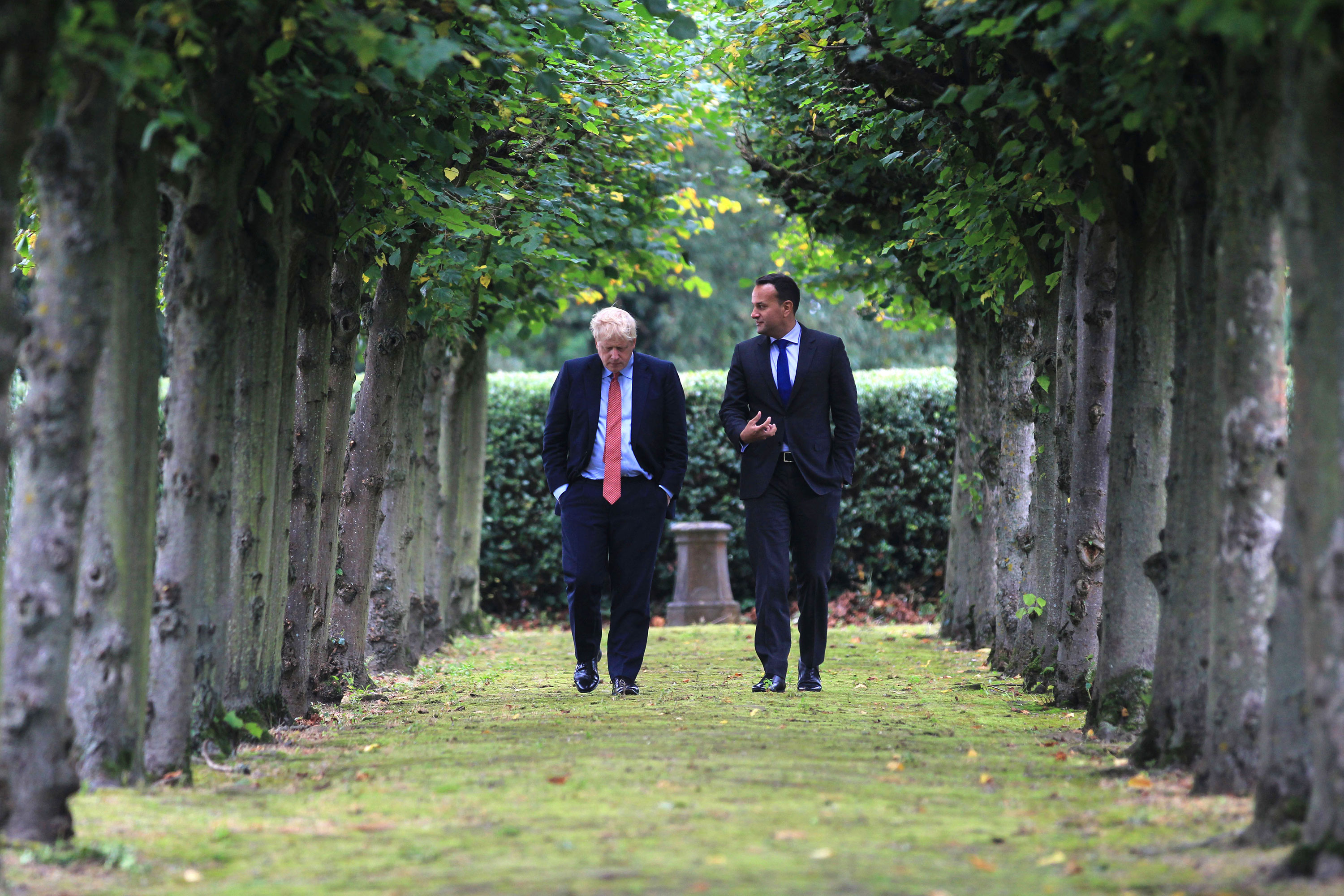 Boris Johnson and Leo Varadkar take a walk in the woods at Thornton Manor, northwest England.
