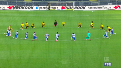 Dortmund and Hertha playerskneel in solidarity of the Black Lives Matter movement.