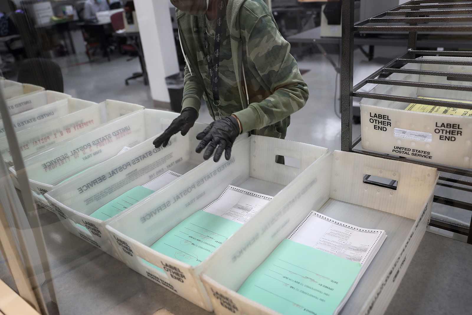 A worker at the Miami-Dade County Elections Department works on tabulating the Vote by Mail ballots that have been returned for the general election on October 30, in Doral, Florida.