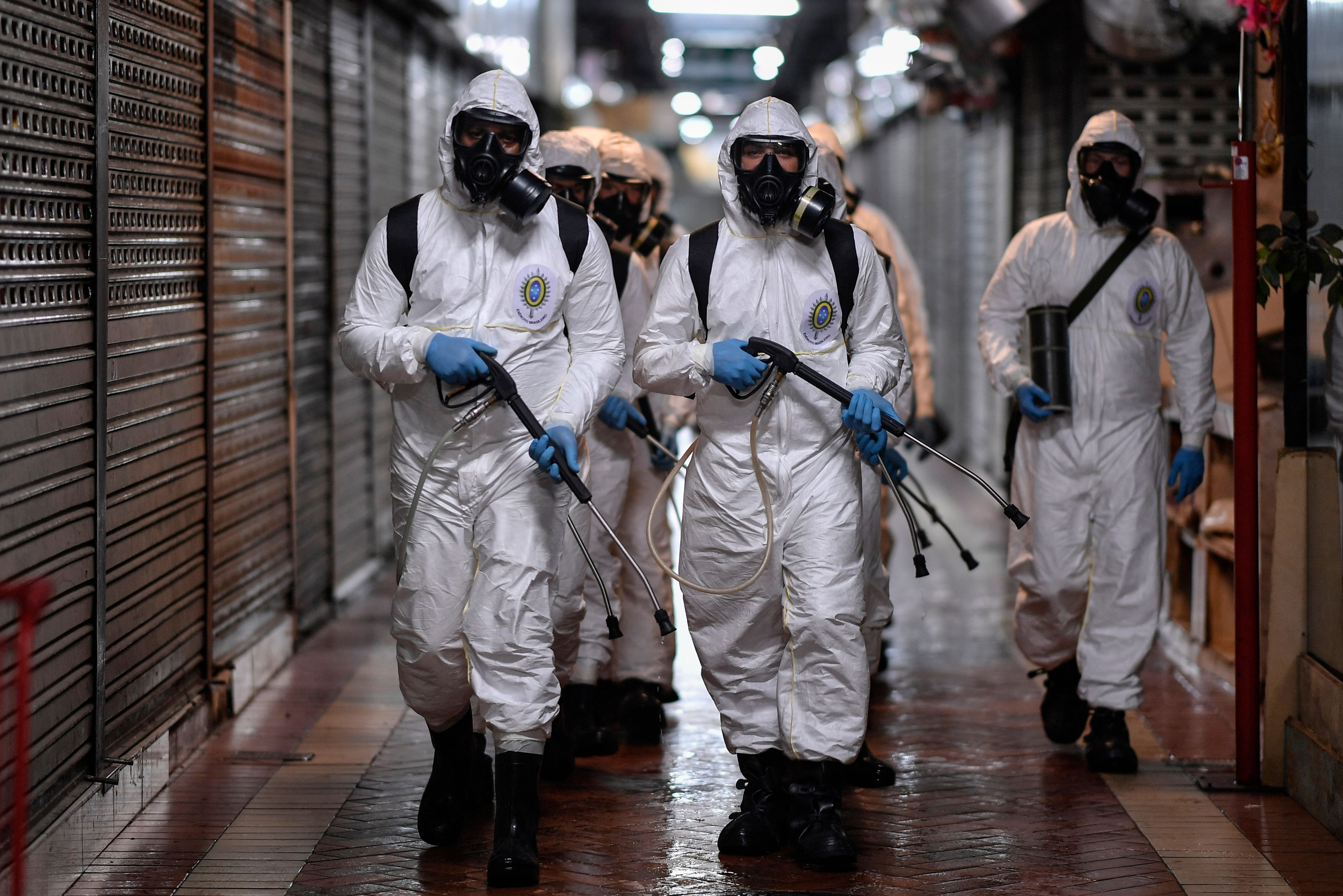 Soldiers from the 4th Military Region of the Brazilian Armed Forces take part in the cleaning and disinfection of the Municipal Market in the Belo Horizonte in Minas Gerais on August 18.