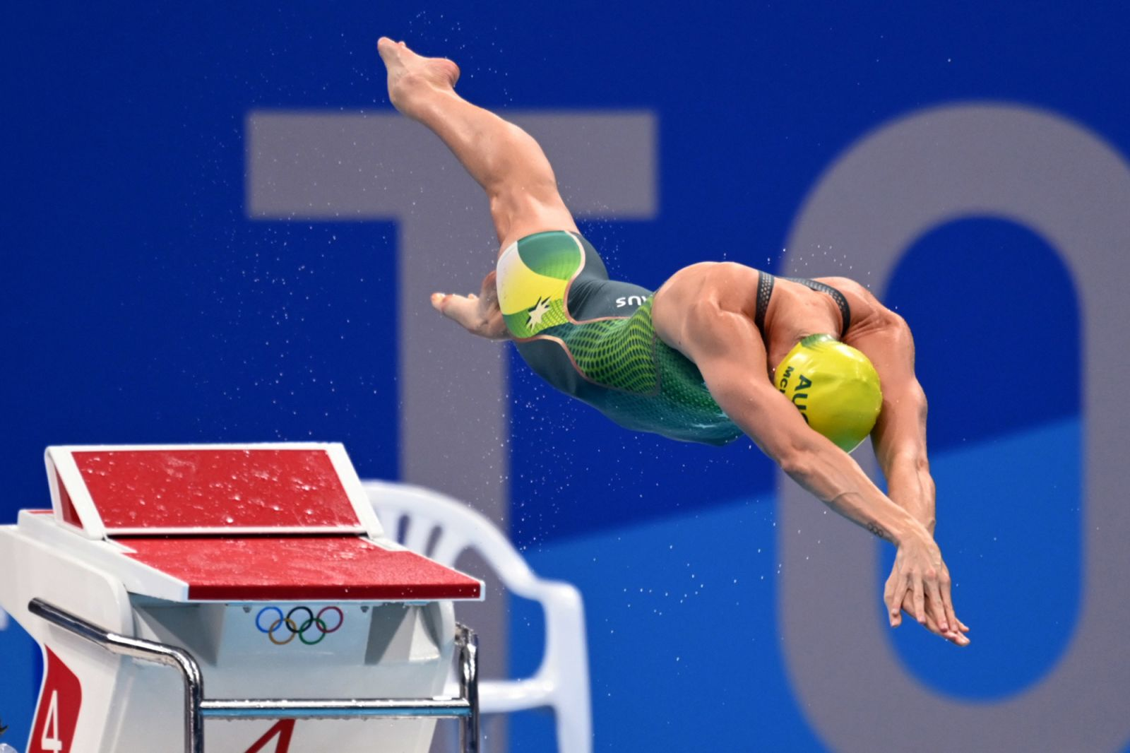 Australian swimmer Emma McKeon dives into the pool at the start of the 50-meter freestyle final on August 1.She won her third gold in Tokyoand set an Olympic record time of 23.81 seconds.