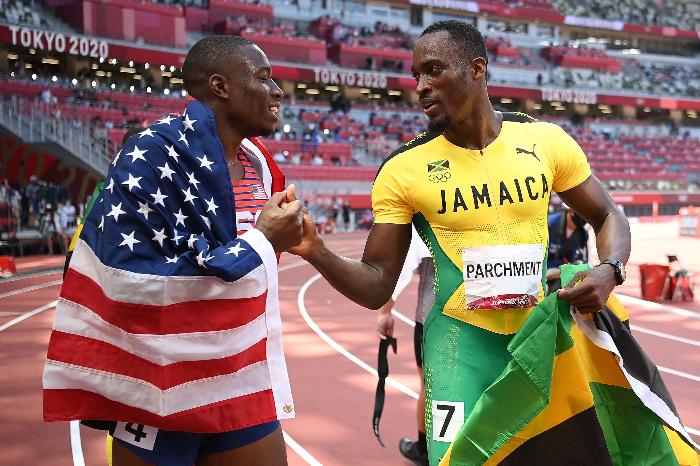 America's Grant Holloway, left, and Jamaica's Hansle Parchment after the 110 meters hurdles final on Thursday, August 5.
