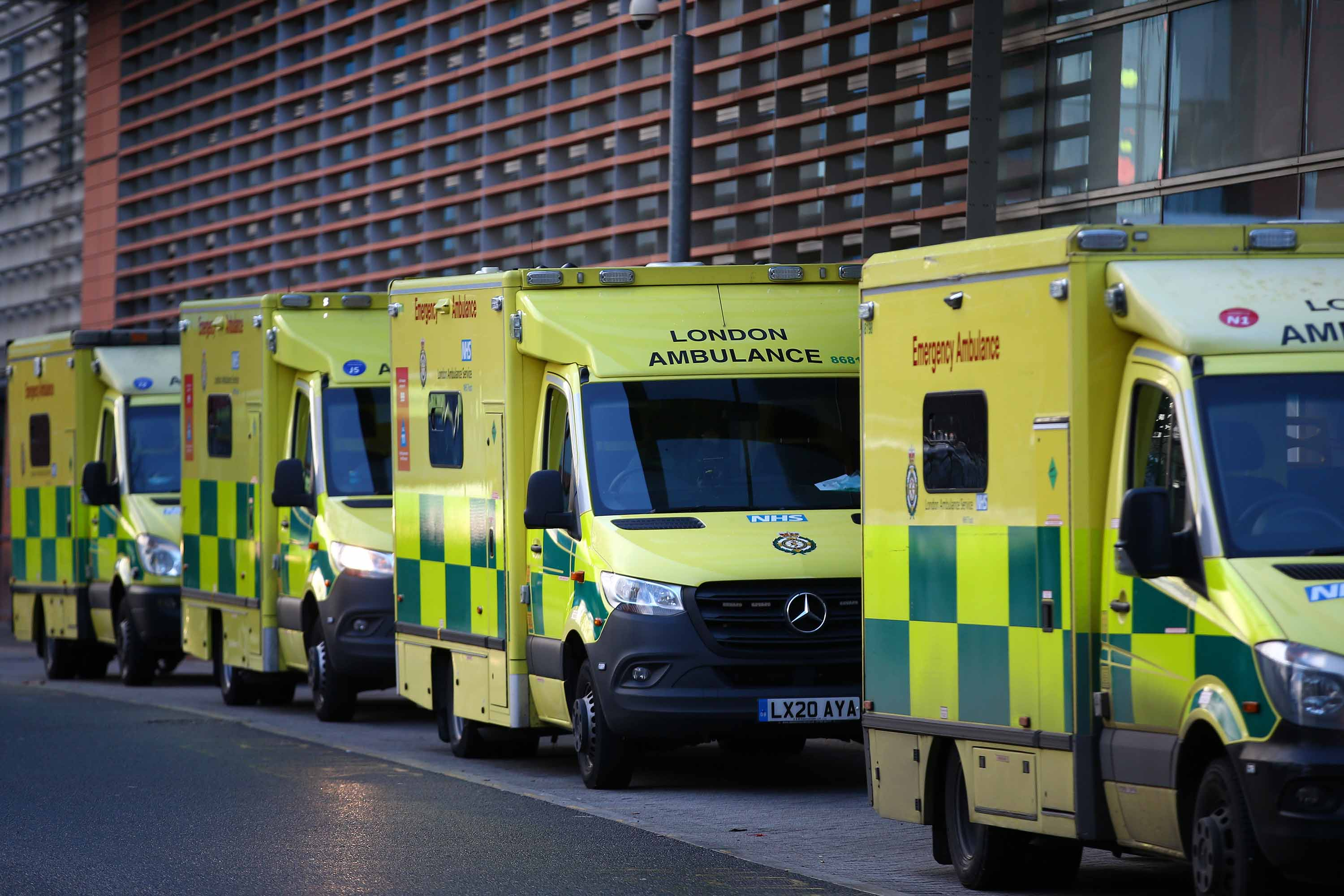 Ambulances are seen parked outside the Royal London Hospital in London, England, on December 27.