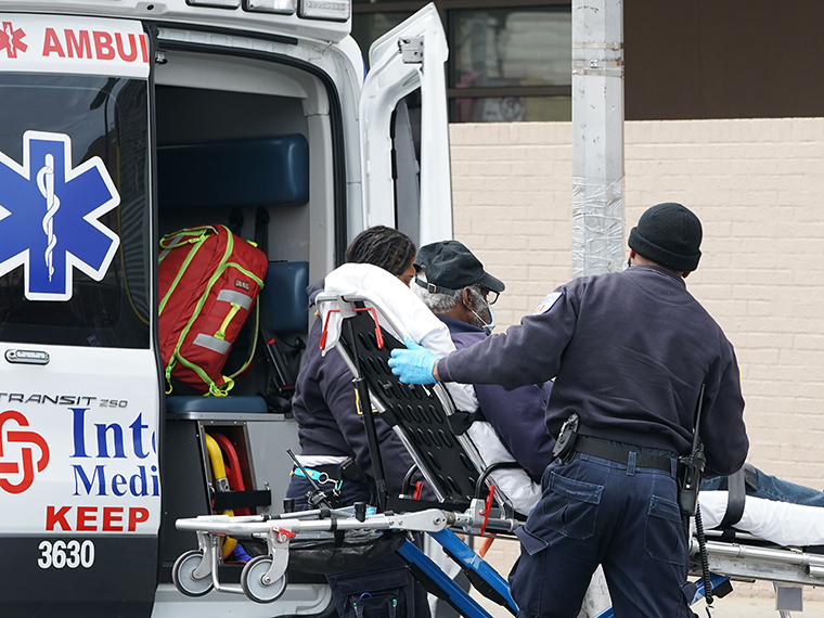 FDNY paramedics bring a patient to Wyckoff Hospital in the Bushwick section of Brooklyn on April 5, in New York.