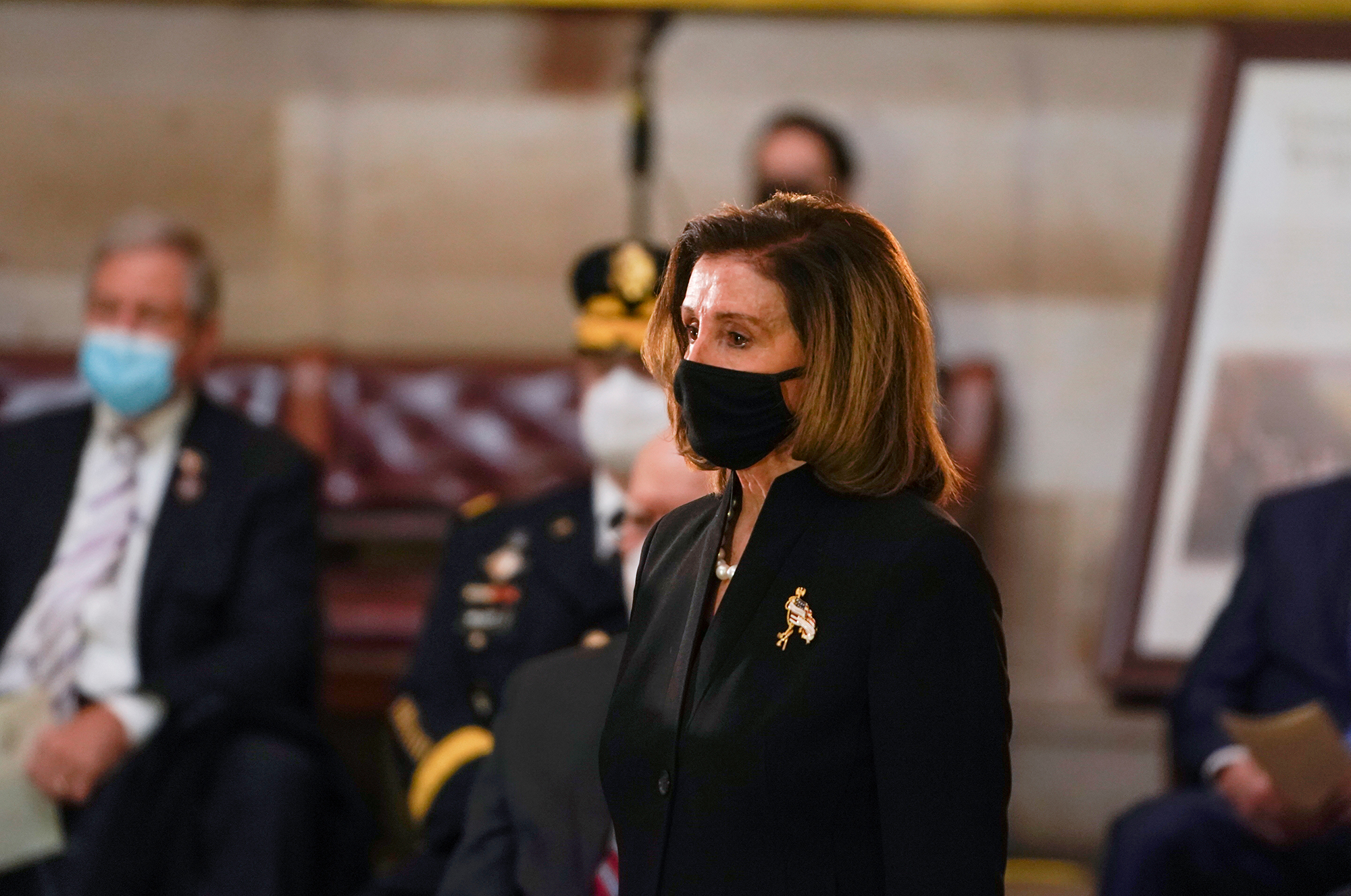 House Speaker Nancy Pelosi of Calif., arrives for a ceremony memorializing U.S. Capitol Police officer Brian Sicknick, as an urn with his cremated remains lies in honor on a black-draped table at the center of the Capitol Rotunda, Wednesday, Feb. 3, 2021, in Washington.