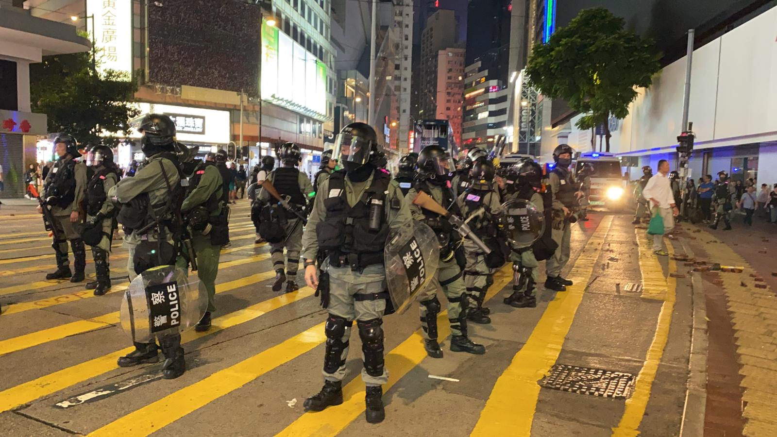 Riot police guard the street in Causeway Bay shopping district, Hong Kong.