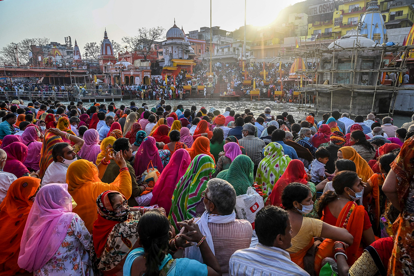 Hindu devotees gather for evening prayers after taking a holy dip in the waters of the River Ganges on the eve of Shahi Snan (grand bath) on Maha Shivratri festival during the ongoing religious Kumbh Mela festival in Haridwar, India, on March 10