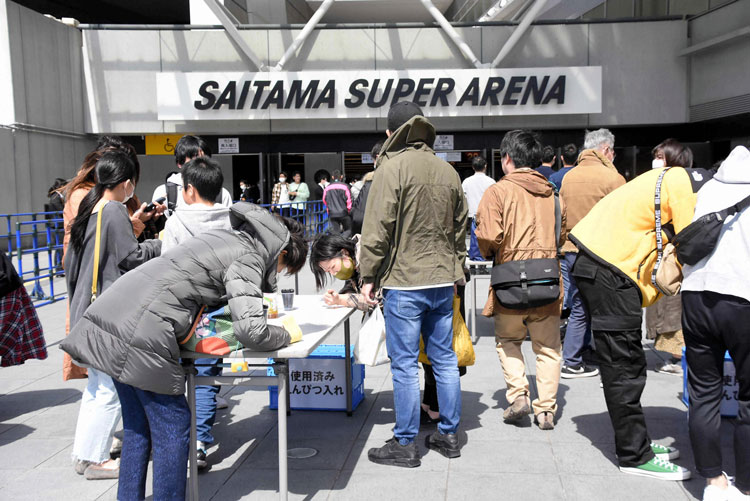 Fans enter the Saitama Super Arena in Saitama, Japan, on Sunday, March 22, for the K-1 World GP event.