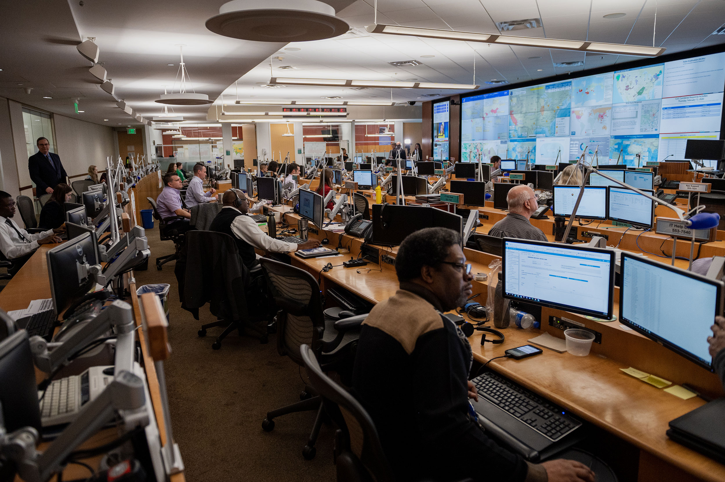 CDC employees work inside of the CDC Emergency Operations Center in Atlanta on January 13.