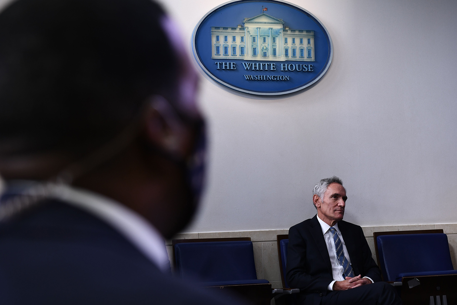 Dr. Scott Atlas listens as President Donald Trump speaks during a news conference in the Brady Briefing Room of the White House in Washington on August 13.