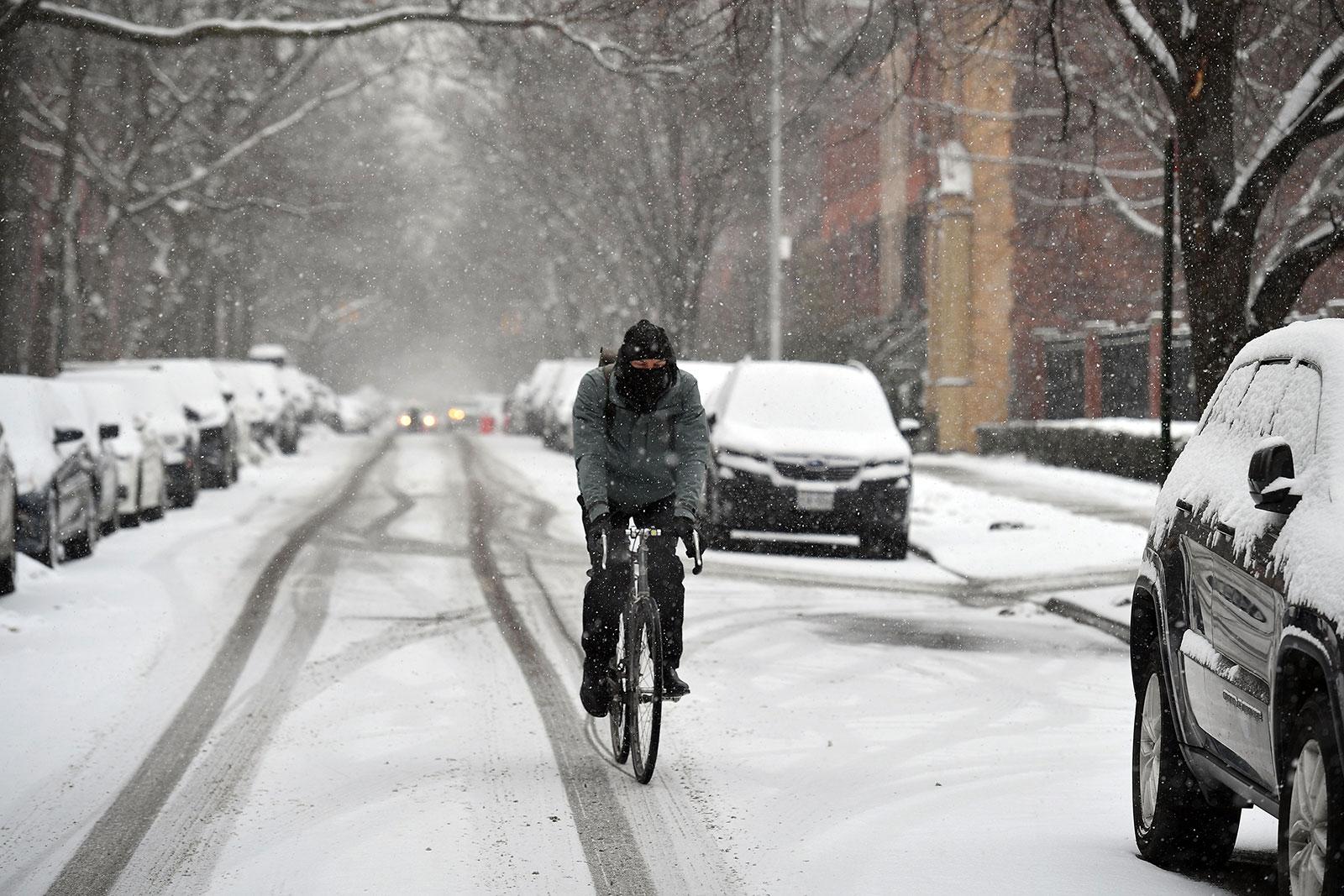 A cyclist rides through Brooklyn, New York, on Thursday, February 18.