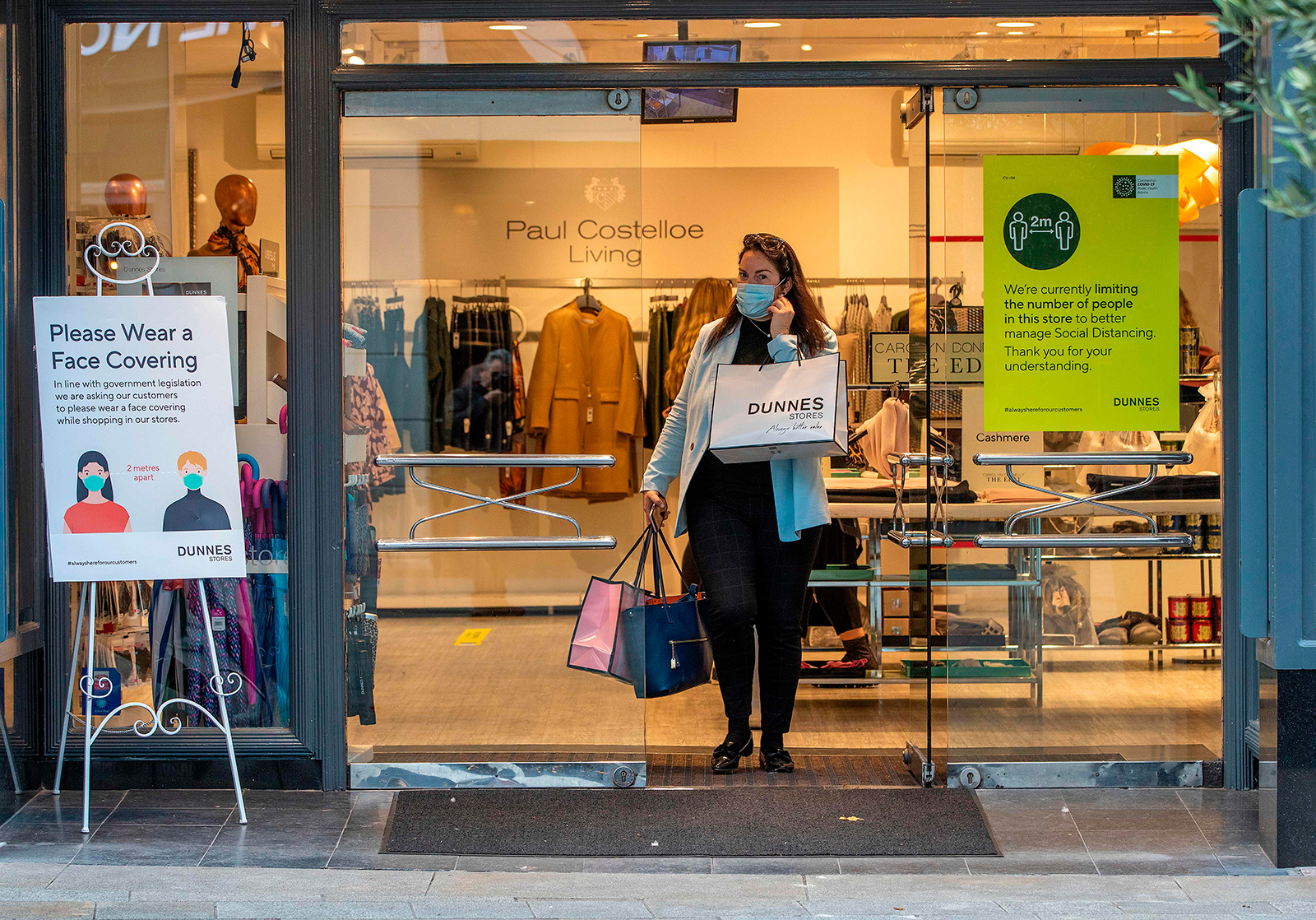 A shopper exits a store in Grafton Street in Dublin on Oct. 21.