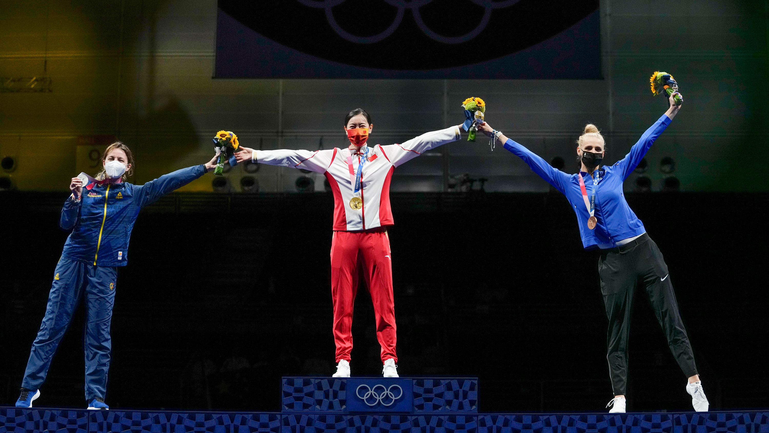 From left, silver medalist Ana Maria Popescu of Romenia, gold medalist Sun Yiwen of China and bronze medalist Katrina Lehis of Estoniac celebrate on the podium of the individual Epee final competition on July 24.
