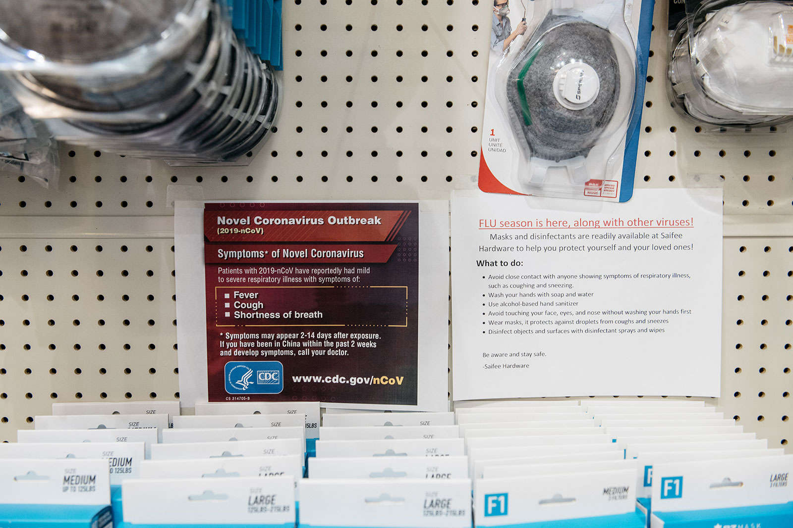 Signs detailing the Center for Disease Control'sadvice for combatting Coronavirus are displayed above facemasks at a Manhattan hardware store in New York City on February 26.