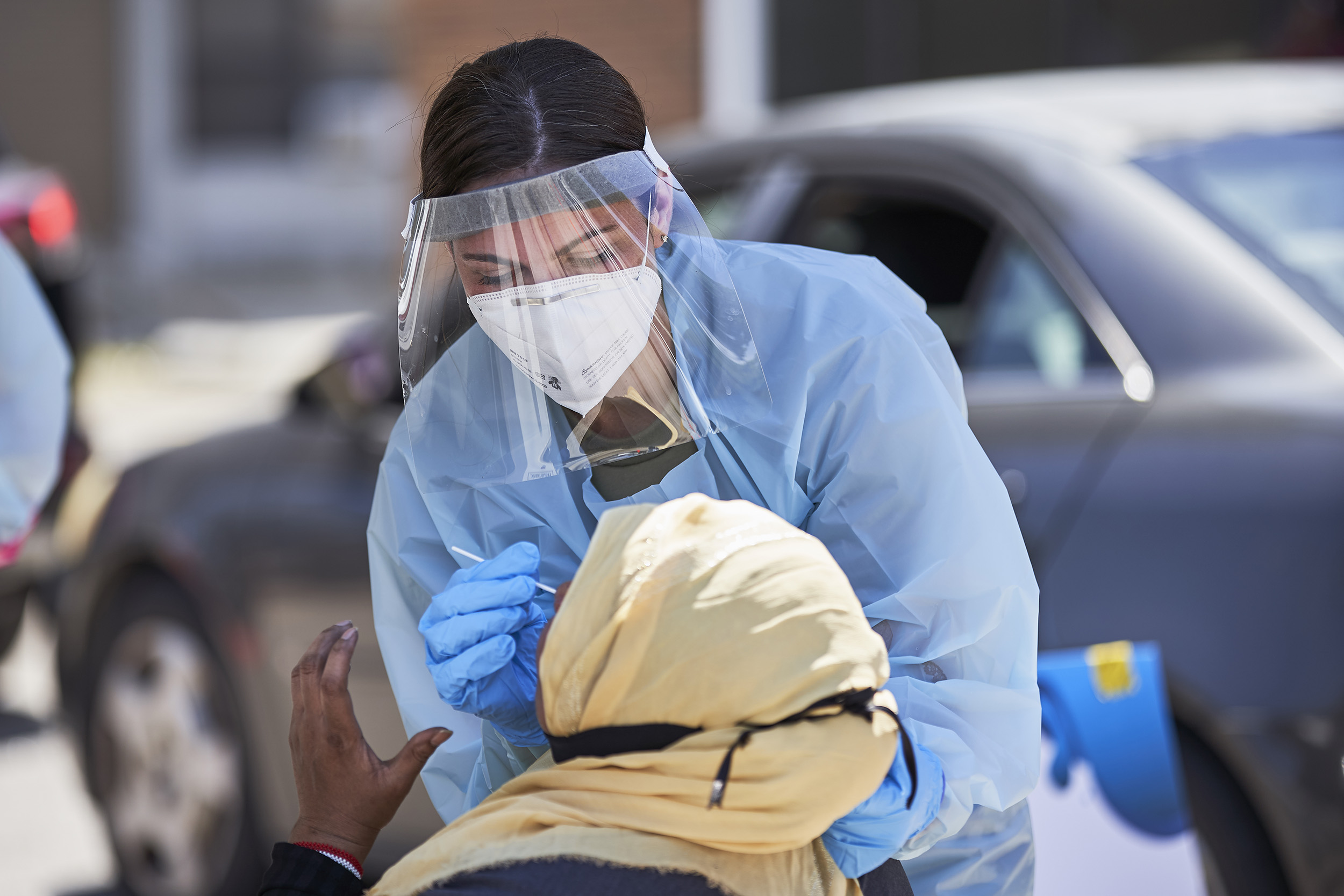 A nurse administers a coronavirus test in Omaha, Nebraska, on July 10.