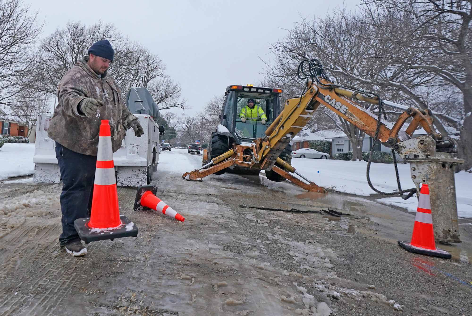 City of Richardson workers prepare to work on a water main pipe that burst due to extreme cold on February 17 in Richardson, Texas.