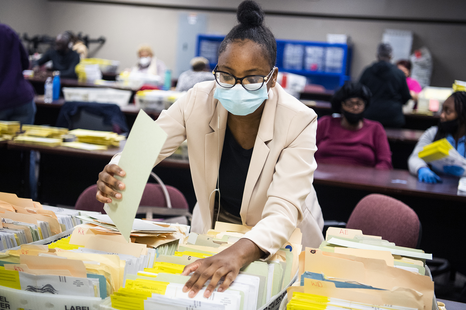 In this Monday, November 2 photo, election workers sort ballots at the DeKalb County Voter Registration and Elections office in Decatur, Georgia.