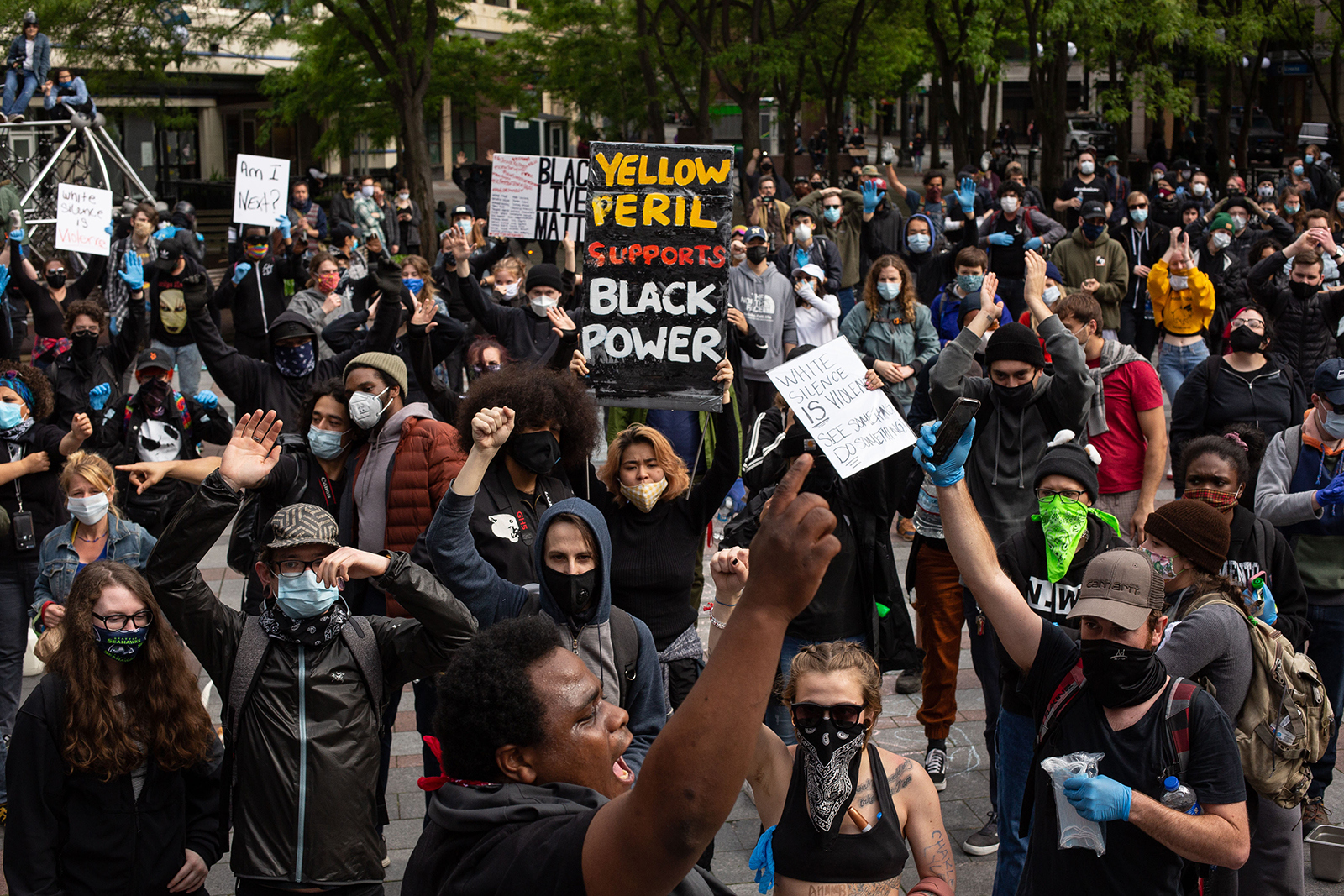 Demonstrators chant during a gathering on May 31, in Seattle.