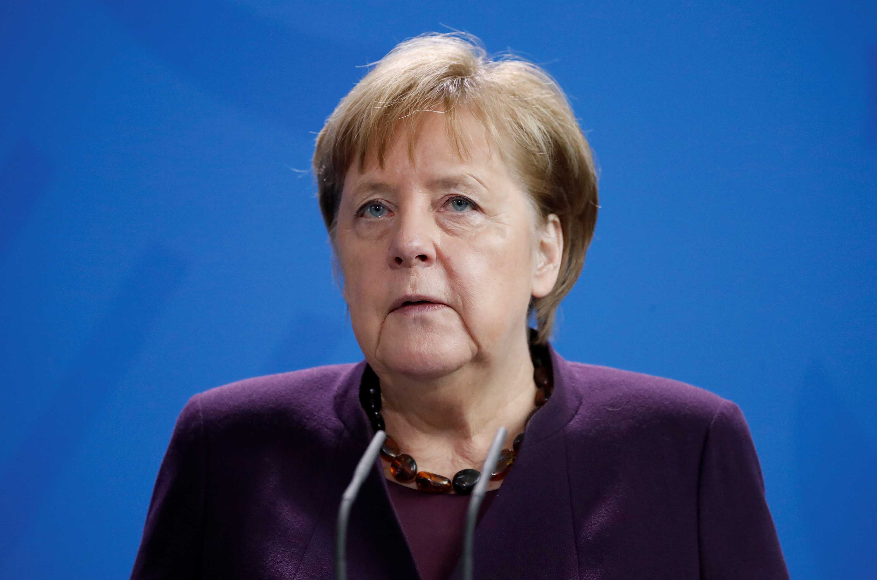 German Chancellor Angela Merkel gives a statement in Berlin on Thursday, following the shootings in Hanau, Germany.