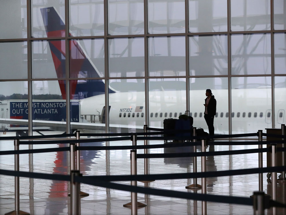 A Delta airplane sits at the International Terminal at Hartsfield-Jackson International Airport in Atlanta on Monday, March 16.