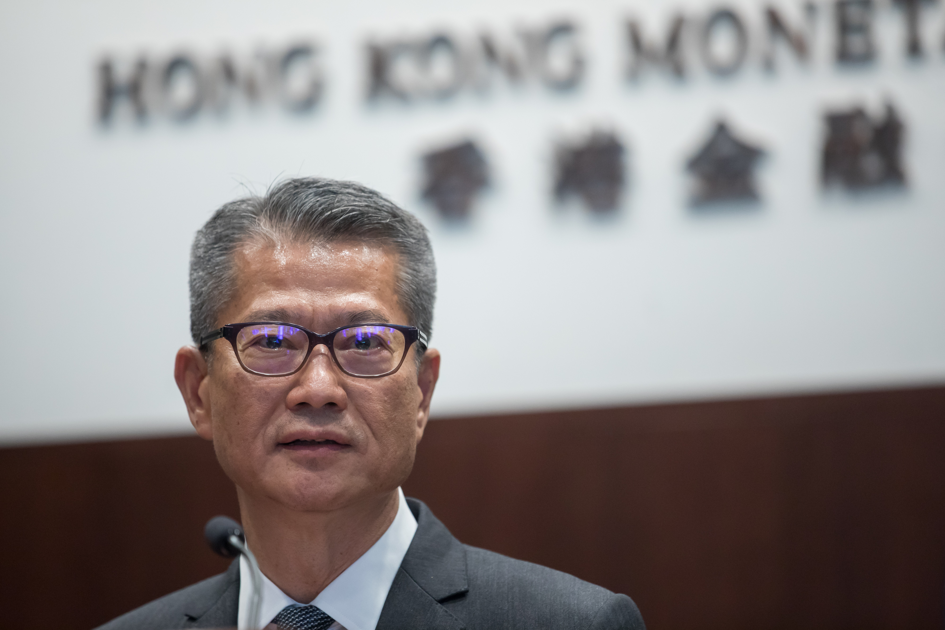 Paul Chan, Hong Kong's financial secretary, speaks during a news conference on July 25.