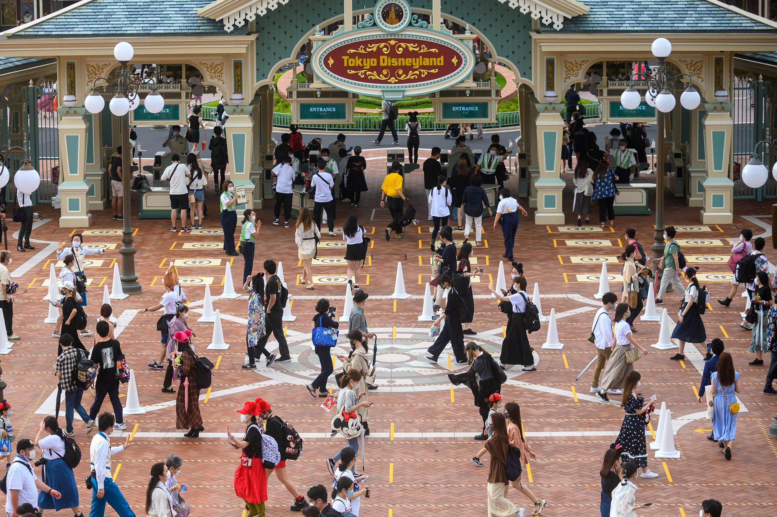 People arrive at Tokyo Disneyland on the reopening day on July 1, in Tokyo, Japan.