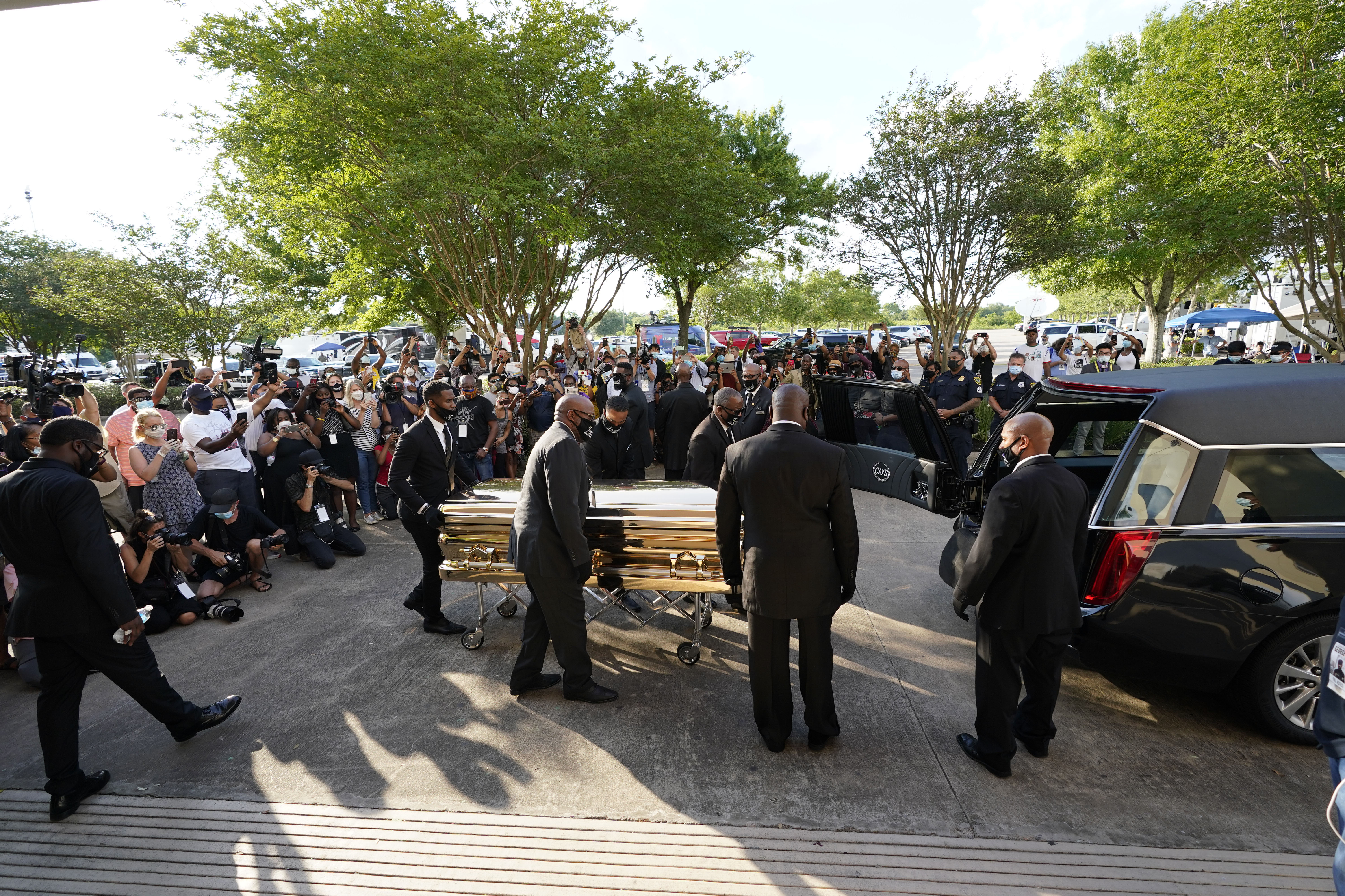 The casket of George Floyd is removed after a public visitation at the Fountain of Praise church in Houston on June 8.