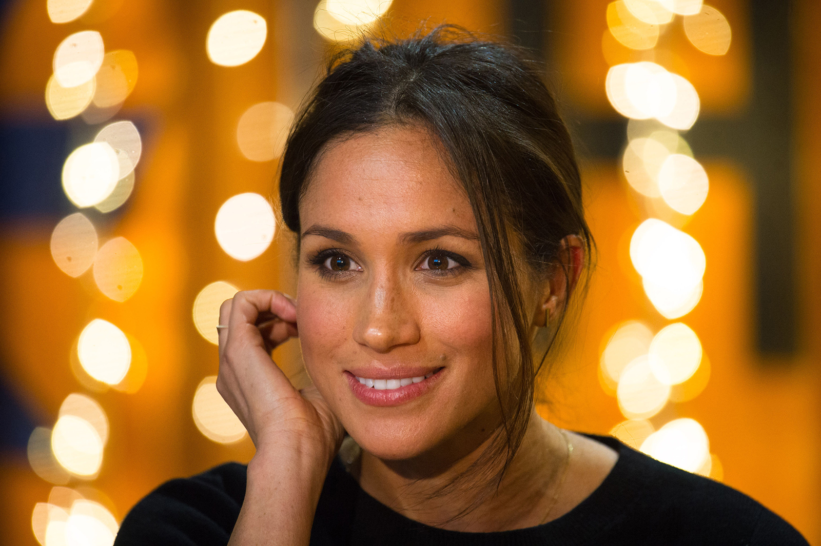 Britain's Prince Harry's fiancée Meghan Markle gestures during a visit to Reprezent 107.3FM community radio station in Brixton, south west London on January 9, 2018.