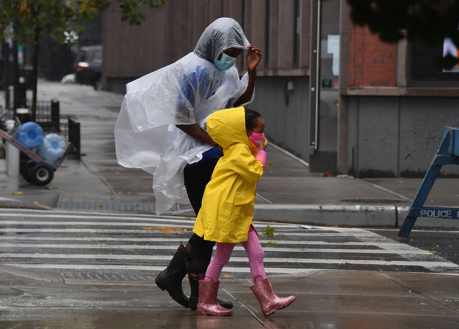 Residents walk through the rain as Tropical Storm Isaias approaches New York City on August 4.