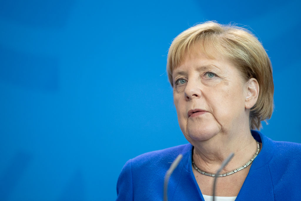 Angela Merkel talks to reporters on Wednesday.