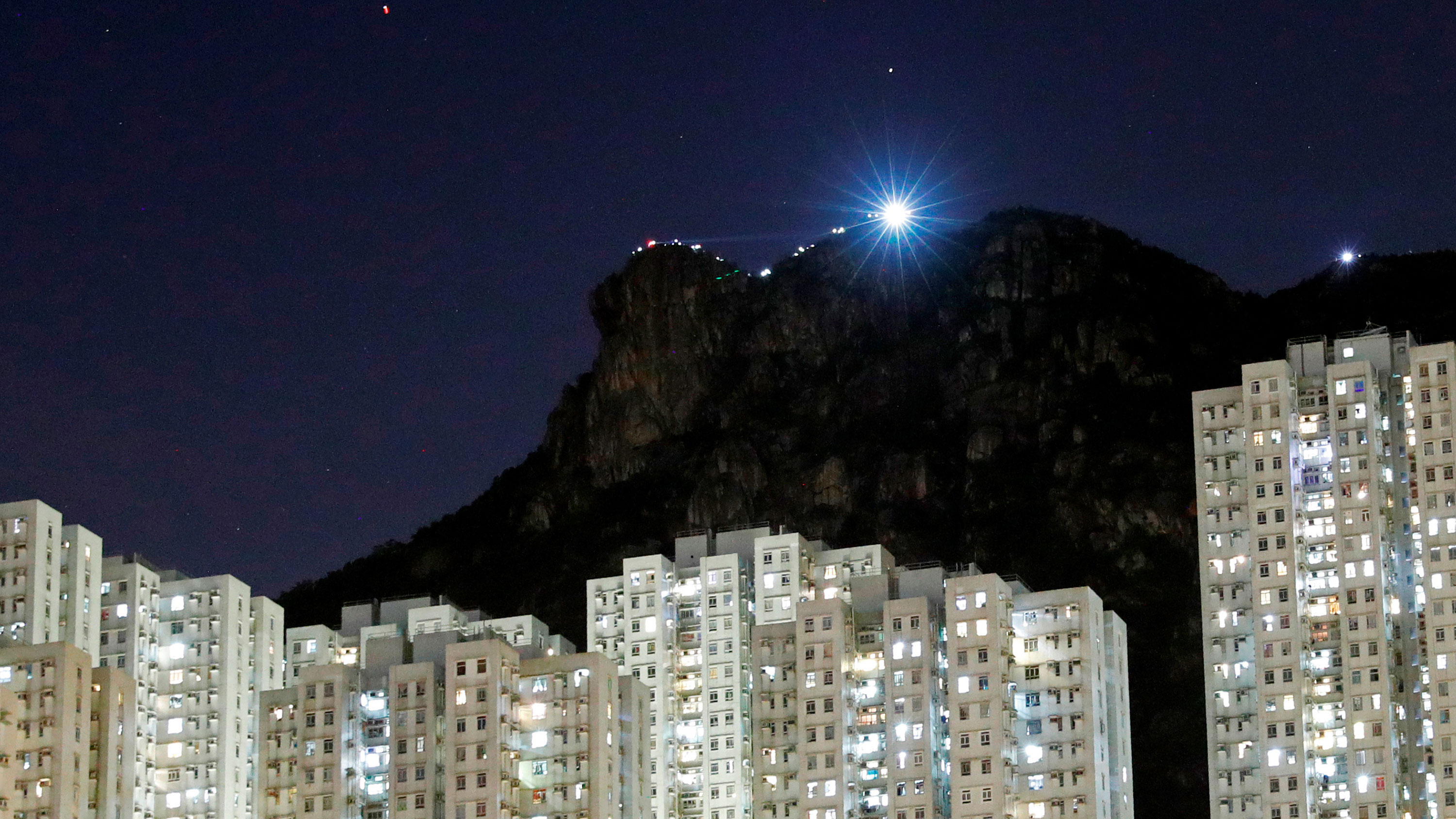 Hong Kong's Lion Rock lit up as protesters gathered at its peak.