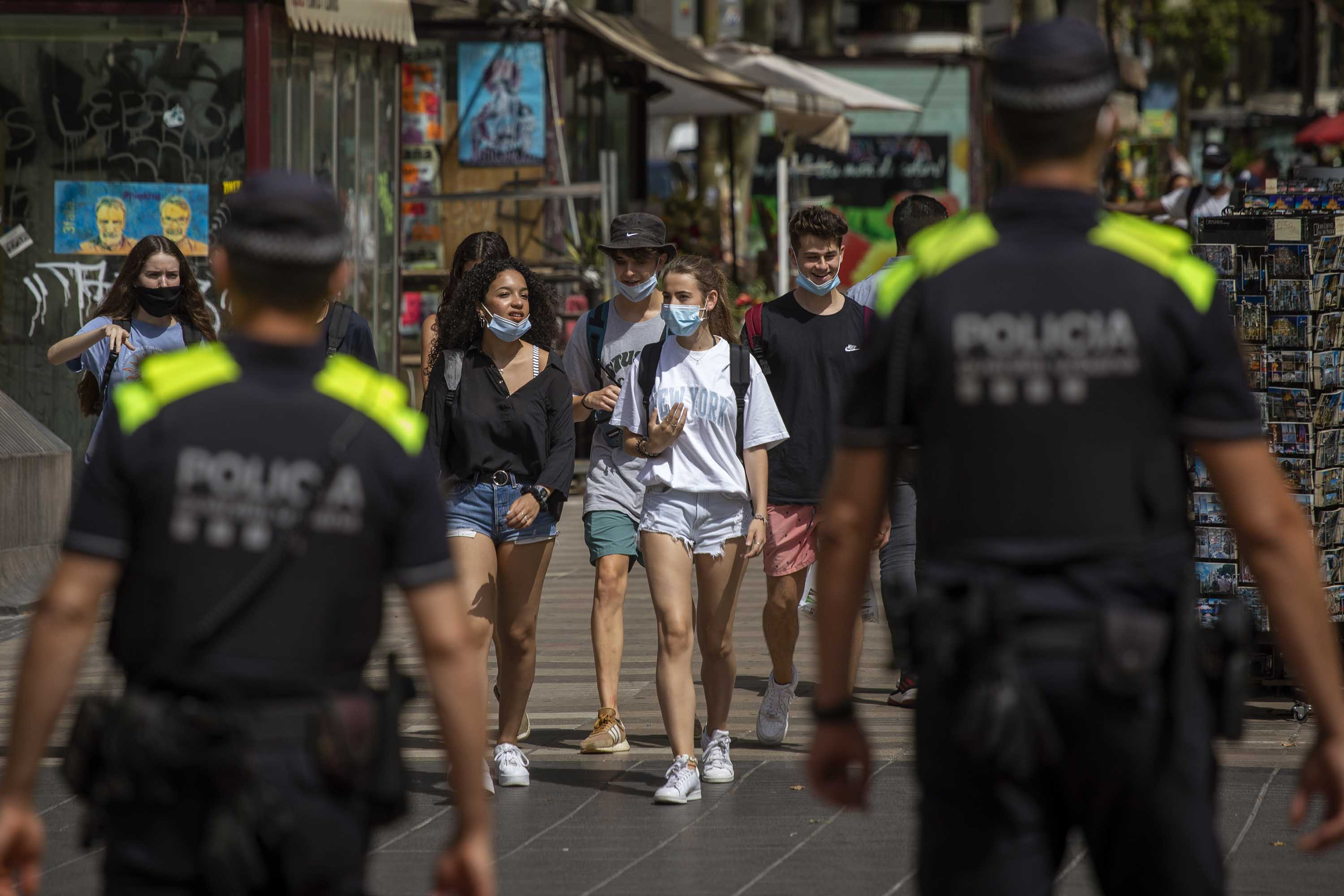Catalan police officers patrol Las Ramblas in Barcelona, Spain, on Thursday, July 9, as the wearing of face masks in public became mandatory in the region.