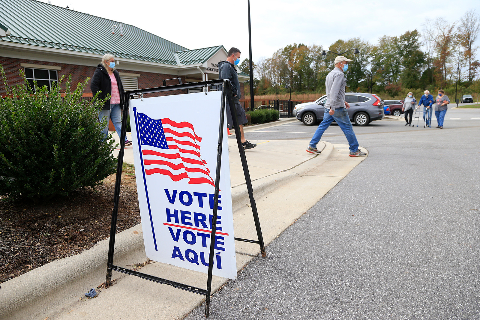Voters arrive and depart a polling place on October 31, in Yadkinville, North Carolina.