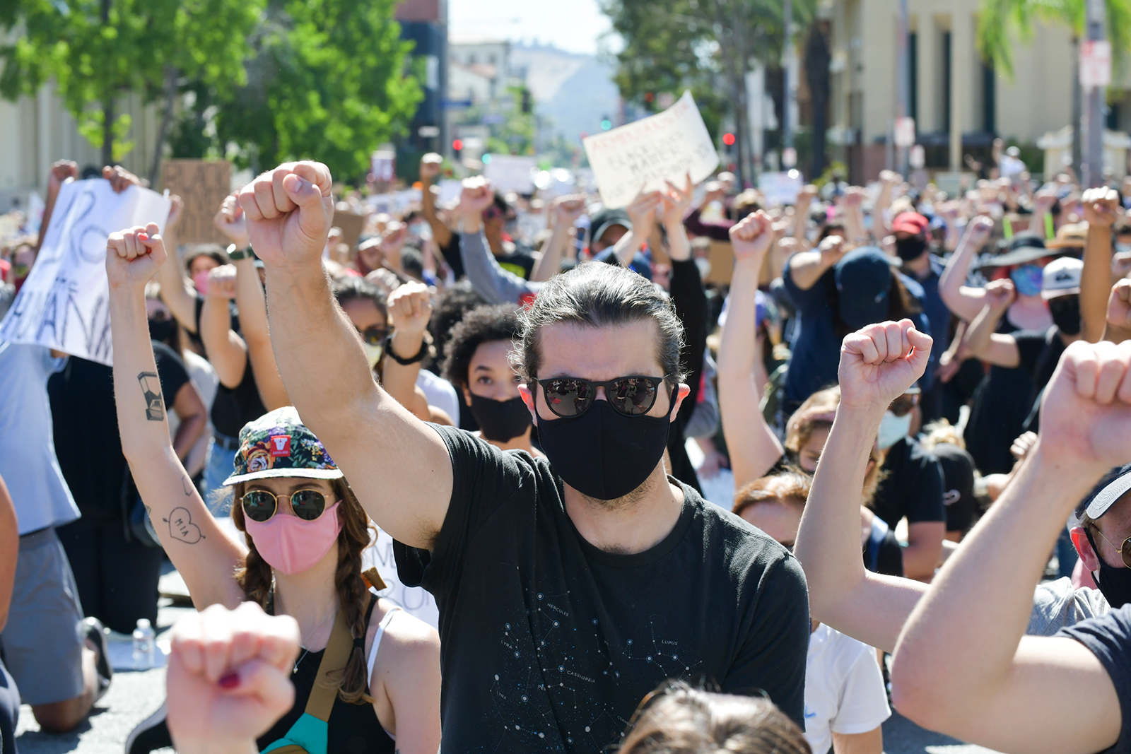 Protesters raise fists in solidarity at the Glendale Community March and Vigil for Black Lives Matter on June 7, in Glendale, California.