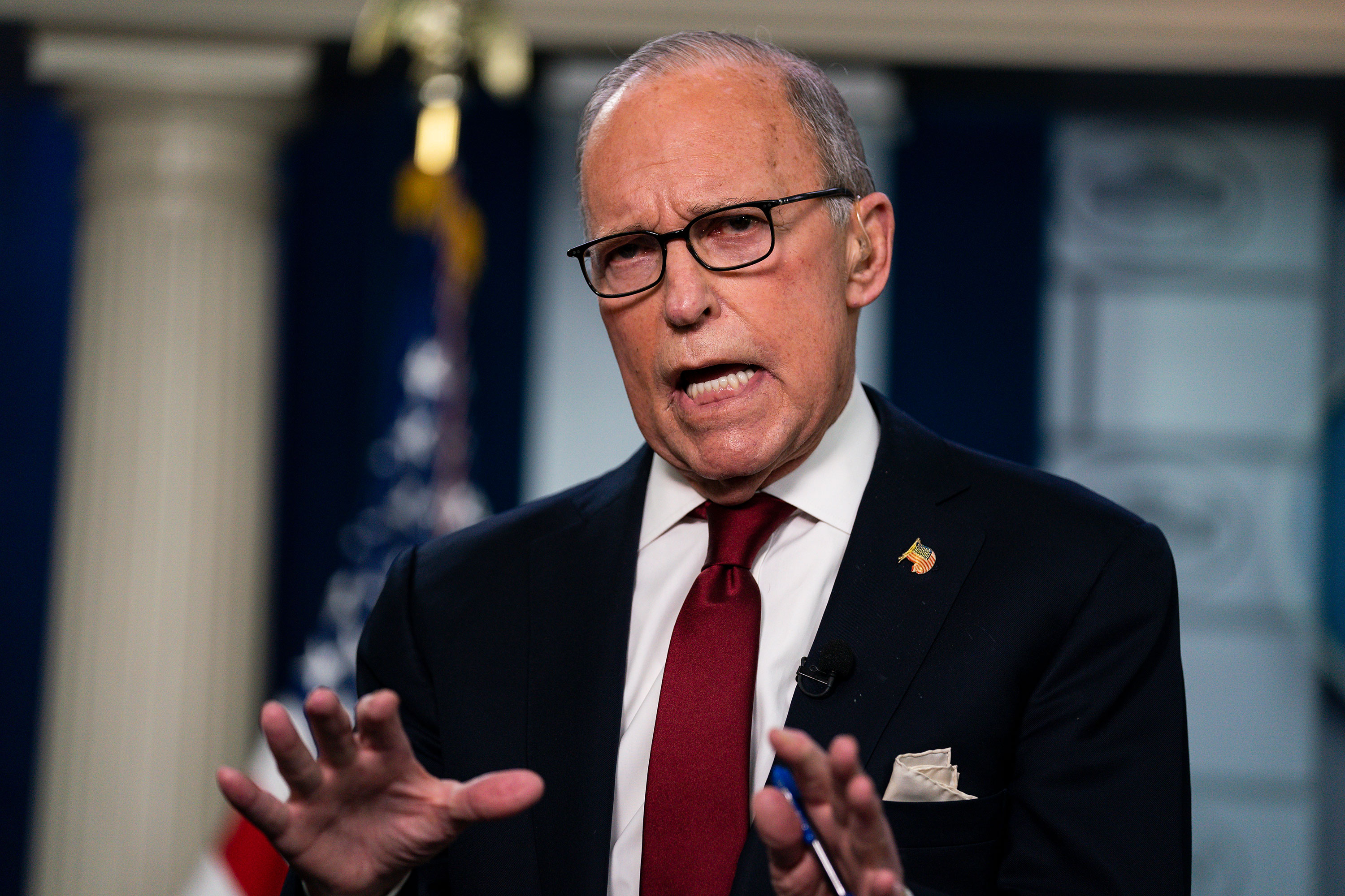 Larry Kudlow talks with reporters on February 28.